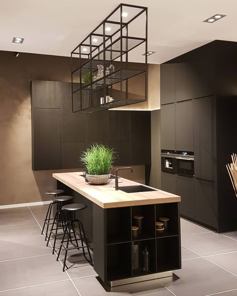 **pronorm display kitchen with free-hanging geometric shelving from ceiling