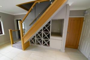 bespoke wine storage under stairs