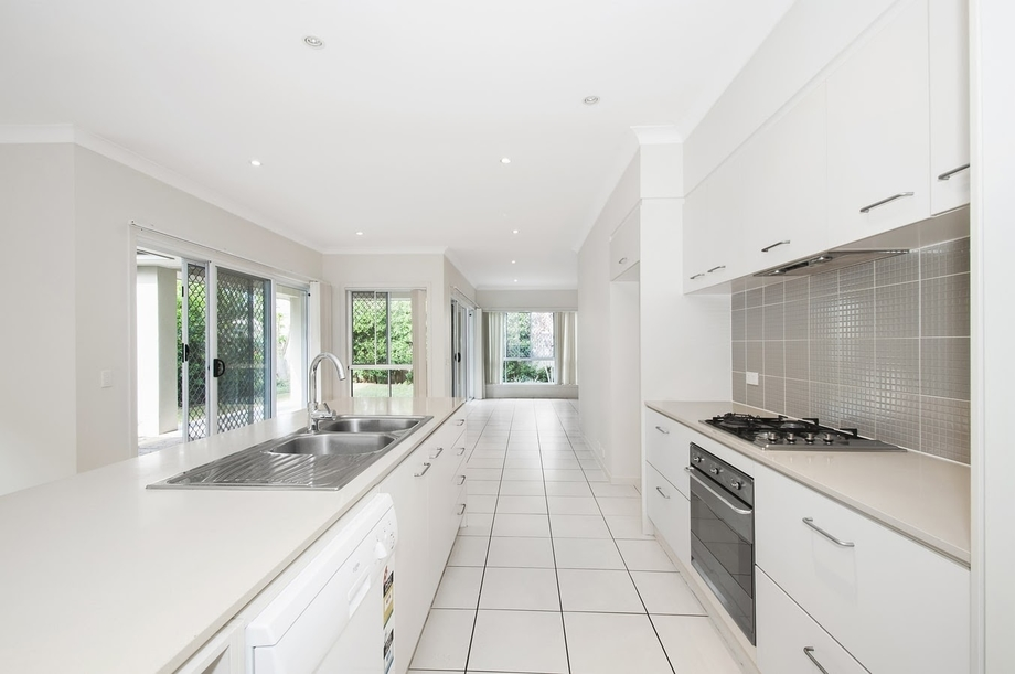 white and neutral kitchen with flat fronted cabinets.jpeg